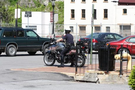 Police officer on motorcycle in parking lot