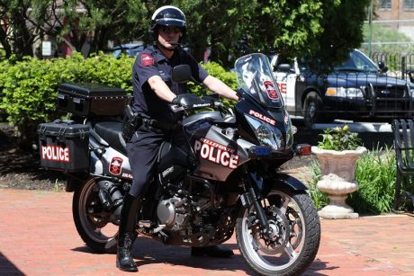 Police officer on parked motorcycle